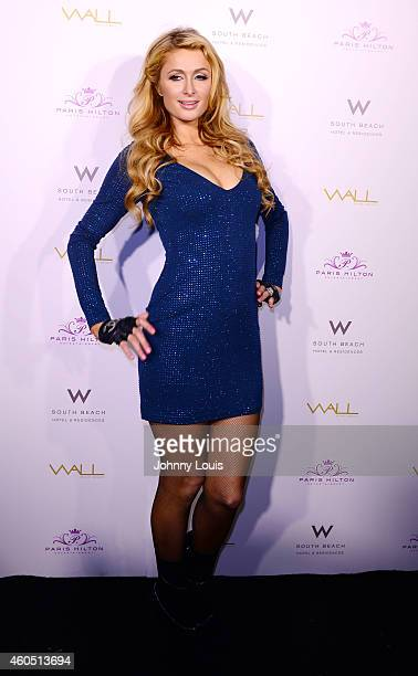 Paris Hilton walks the red carpet before DJ's at Wall at W Hotel on December 5 2014 in Miami Beach Florida