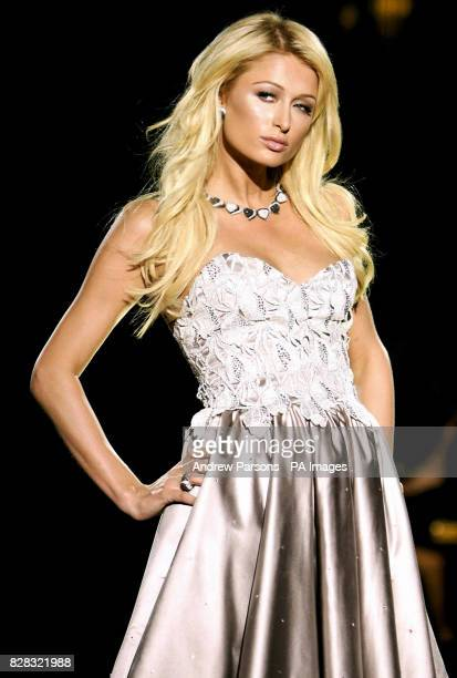 Paris Hilton wearing De Grisogono diamonds on the catwalk during designer Julien MacDonald's show for the 2006 London fashion week from the...