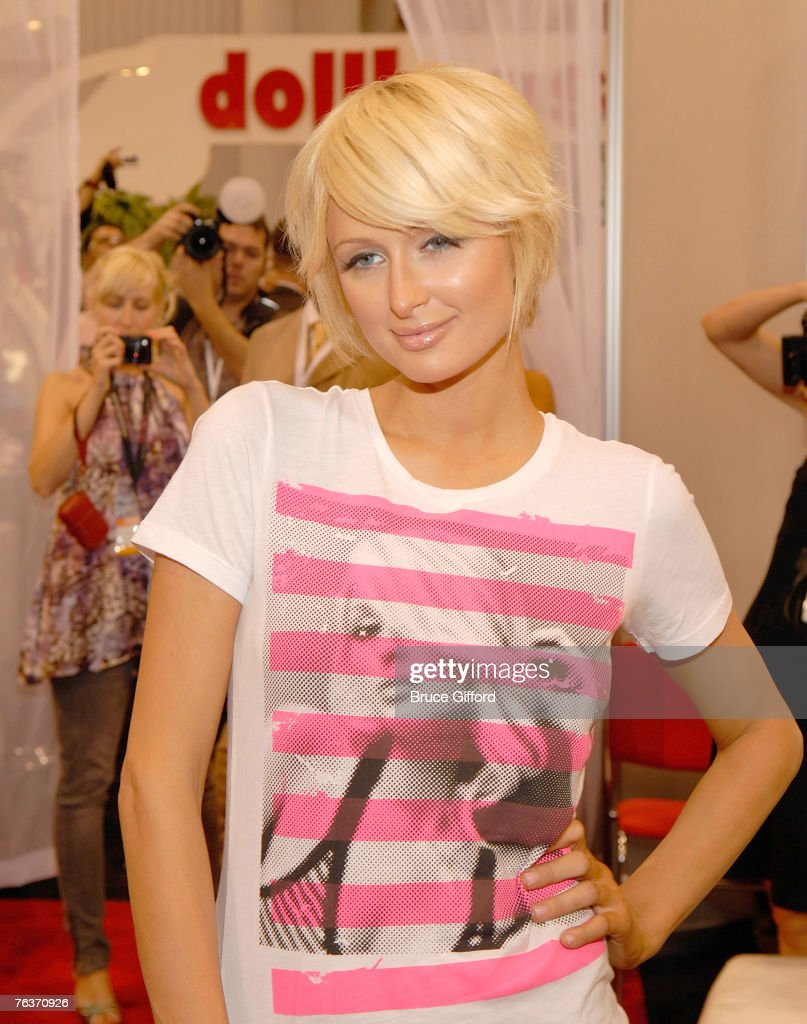 Paris Hilton wears items from her new Paris Hilton clothing line at the Dollhouse booth at the MAGIC convention at the Las Vegas Convention Center August 28, 2007 in Las Vegas, Nevada. Dollhouse is the exclusive licensee for Hilton's fashion line.