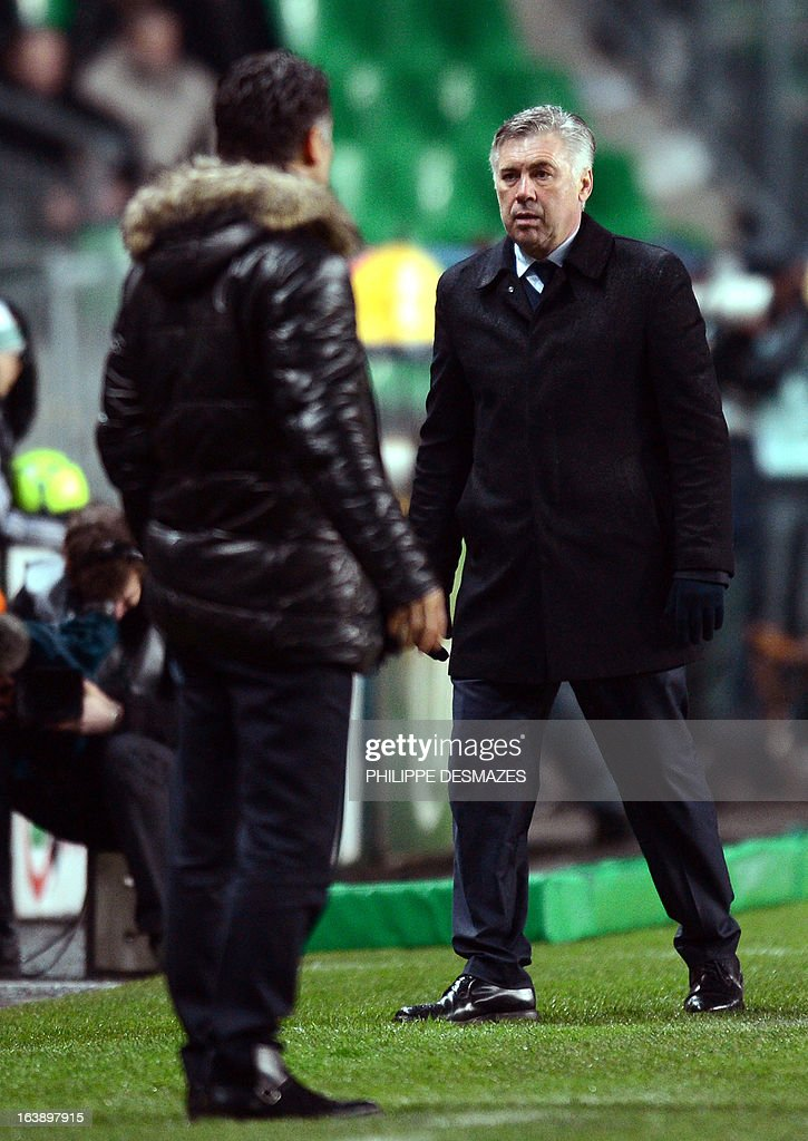 Paris' Italian coach Carlo Ancelotti (R) and Saint-Etienne's French coach Christophe Galtier attend the French L1 football match Association Sportive de Saint-Etienne (ASSE) vs Paris Saint-Germain (PSG) on March 17, 2013 at the Geoffroy Guichard stadium in Saint-Etienne, southeasthern France. AFP PHOTO/PHILIPPE DESMAZES