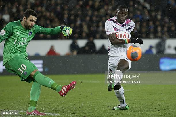 Paris' Italian goalkeeper Salvatore Sirigu kicks the ball in front of Bordeaux's Senegalese forward Henri Saivet during a French L1 football match...