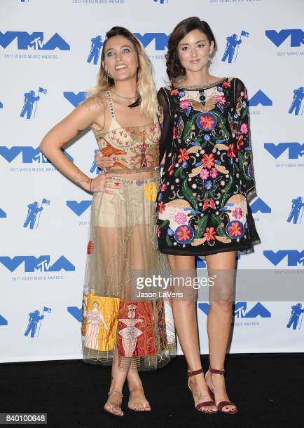 Paris Jackson and Caroline D'Amore pose in the press room at the 2017 MTV Video Music Awards at The Forum on August 27 2017 in Inglewood California