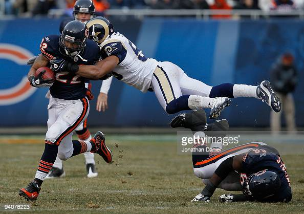 Paris Lenon of the St Louis Rams leaps over Frank Omiyale of the Chicago Bears to try and tackle Matt Forte at Soldier Field on December 6 2009 in...