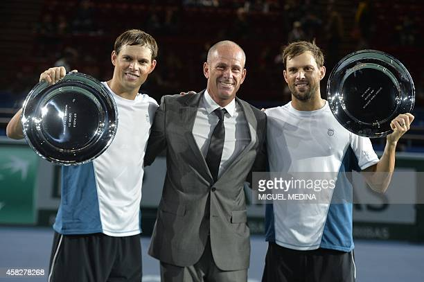 Paris Masters 1000 President Guy Forget poses with US players Bob Bryan and Mike Bryan with the trophy after they won the doubles final match against...