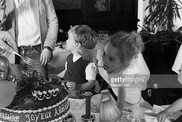 Paris May 14 the fivetime family BRUNNER celebrate their third anniversary at Maxim's Children a table are eager to eat their birthday cake