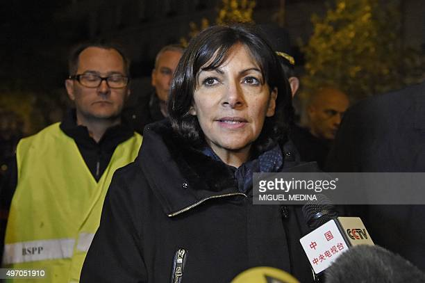 Paris mayor Anne Hidalgo addresses the media near the Bataclan concert hall in central Paris early on November 14 2015 At least 120 people were...