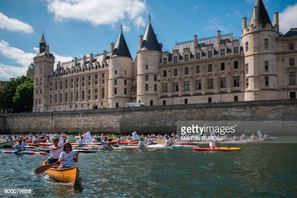 TOPSHOT Paris Mayor Anne Hidalgo and the copresident of the Paris bid for the 2024 Olympics Tony Estanguet sail on the Seine river in Paris on June...