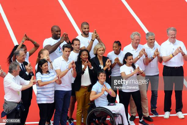 Paris Mayor Anne Hidalgo and Tony Estanguet copresident of the Paris candicacy for the 2024 Olympics French Sports minister Laura Flessel Ile de...