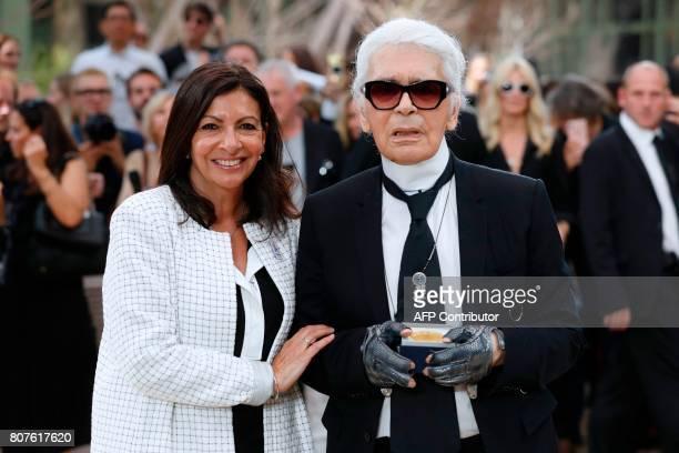 Paris' Mayor Anne Hidalgo awards the Grand Vermeil De La Ville De Paris medal to German fashion designer Karl Lagerfeld after Chanel 20172018...