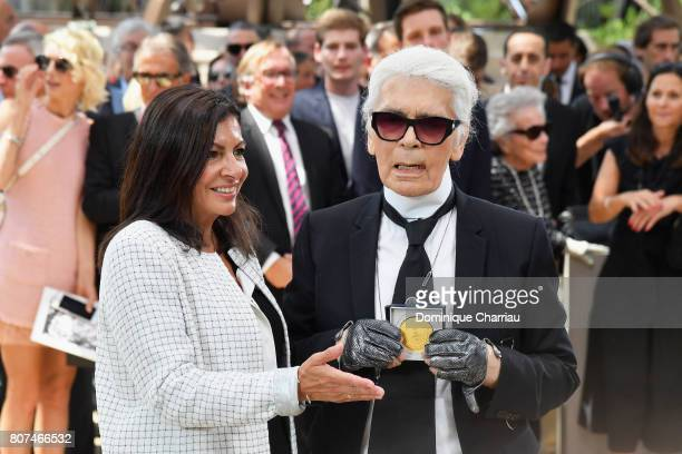 Paris Mayor Anne Hidalgo Decorates Karl Lagerfeld after the Chanel Show Haute Couture Fall/Winter 20172018 on July 4 2017 in Paris France