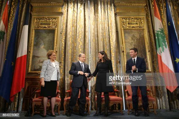 Paris Mayor Anne Hidalgo flanked by French Junior Minister for Economy Benjamin Griveaux welcomes Lebanon's President Michel Aoun and his wife Nadia...