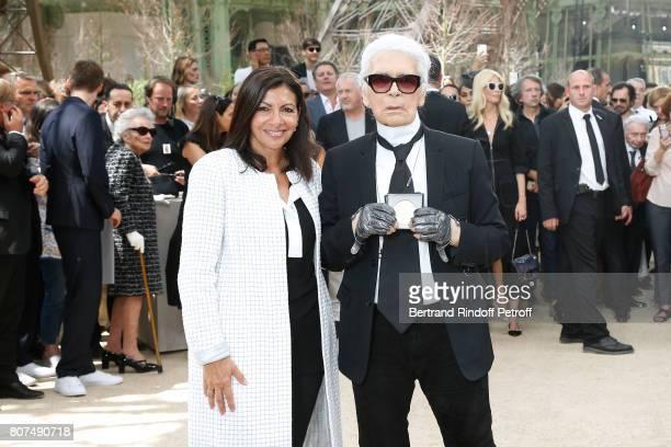 Paris Mayor Anne Hidalgo gives to Karl Lagerfeld the 'Medaille Vermeille de la Ville de Paris' after the Chanel Haute Couture Fall/Winter 20172018...