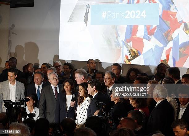 Paris' mayor Anne Hidalgo stands next to IledeFrance regional council JeanPaul Huchon during the official launch of Paris bid for the 2024 Olympics...