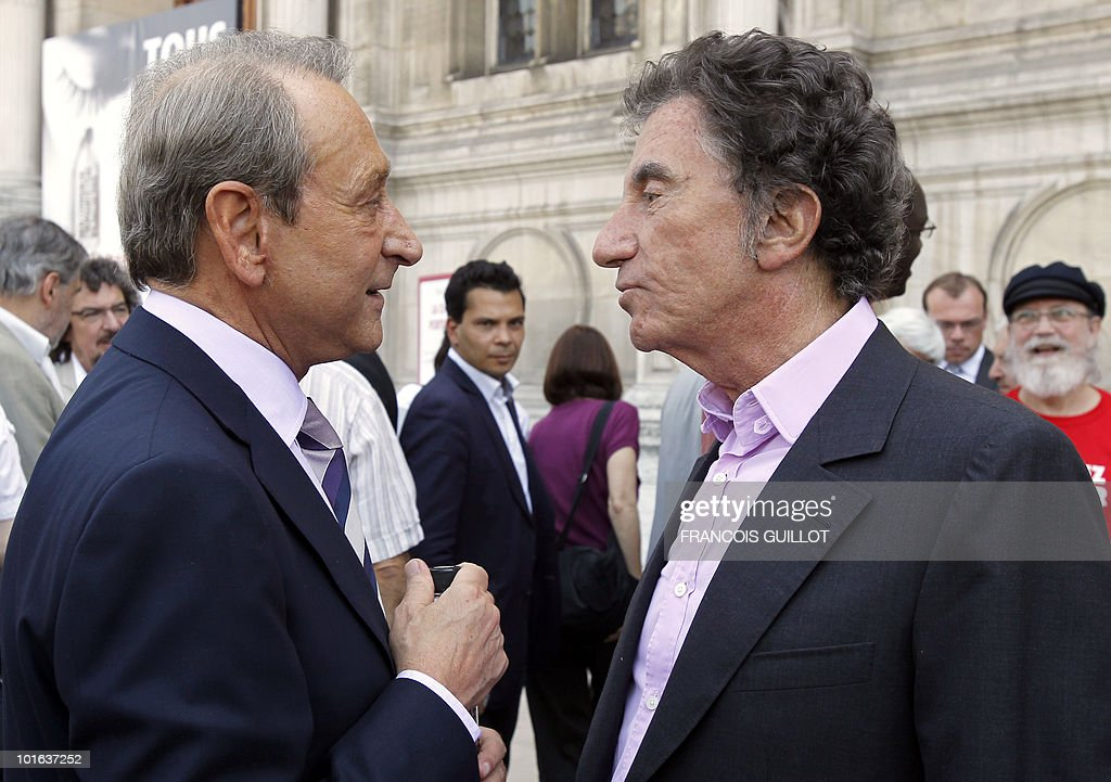 Paris Mayor Bertrand Delanoe (L) and former Culture Minister Jack Lang chat during the launch of the 'Porteurs d'eau' (Water carriers) campaign on June 5, 2010 in front of the Paris City Hall. This operation organized by 'France Libertes', the foundation of late French President Francois Mitterrand's widow, Danielle Mitterrand, with local representatives promotes a free access to water in the world.