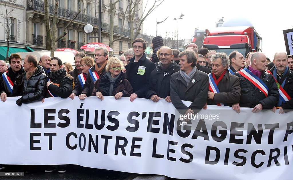 Paris Mayor Bertrand Delanoe (2ndL), Modem centrist party European deputy Jean-Luc Benhamias (3rdL), Ile-de-France regional counsellor Jean-Luc Romero (4thL), French PCF (French Communist Party) member of Parliament, Marie-George Buffet (6thL), PCF leader Pierre Laurent (7thL), former Ecologist presidential candidate Eva Joly (8thL), French Socialist Party (PS) First Secretary Harlem Desir (5thR), Socialist Senator David Assouline (4thR), Paris 4th district Mayor Christophe Girard (2ndR) and MP Denis Baupin (R) take part in a demonstration for the legalisation of gay marriage and LGBT (lesbian, gay, bisexual, and transgender) parenting, in Paris on January 27, 2013, two days before a parliamentary debate on the government's take part in a demonstration for the legalisation of gay marriage and LGBT (lesbian, gay, bisexual, and transgender) parenting, in Paris on January 27, 2013, two days before a parliamentary debate on the government's controversial marriage equality bill, which will allow gay couples the same rights as their straight counterparts. The banner reads : 'The representatives engage themselves for equality now and against discriminations all the time'.