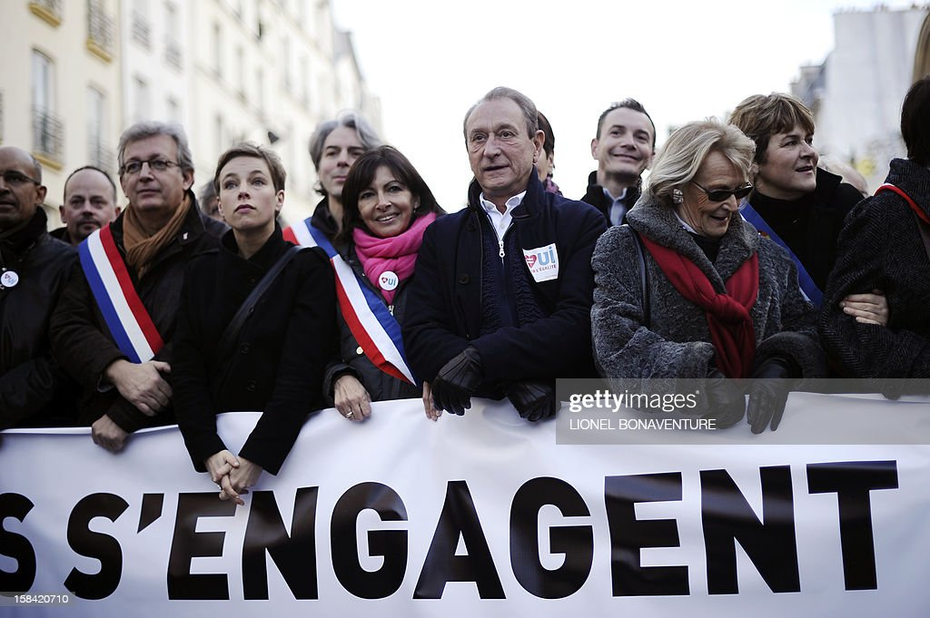 Paris' mayor Bertrand Delanoe (C), Paris deputy mayor Anne Hidalgo (foreground 3rdR) far-left activist Clementine Autain (foreground 2ndL) and head of French communist party Pierre Laurent (L) take part in a demonstration for the legalisation of gay marriage and LGBT (lesbian, gay, bisexual, and transgender) parenting in Paris on December 16, 2012. Background, behind Anne Hidalgo, Jacques Boutault, Mayor of Paris 2nd district AFP PHOTO / LIONEL BONAVENTURE
