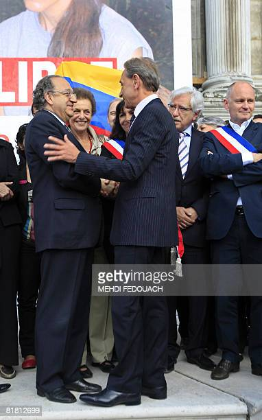 Paris' mayor Bertrand Delanoe shakes hands with Fernando Cepeda Ullo Colombian ambassador in France as people gather on July 3 2008 in front of the...