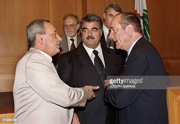 Paris Mayor Jacques Chirac gestures 17 June 1993 as he talks with Lebanon house speaker and former warlord Nabih Berri while Lebanese Premier Rafic...