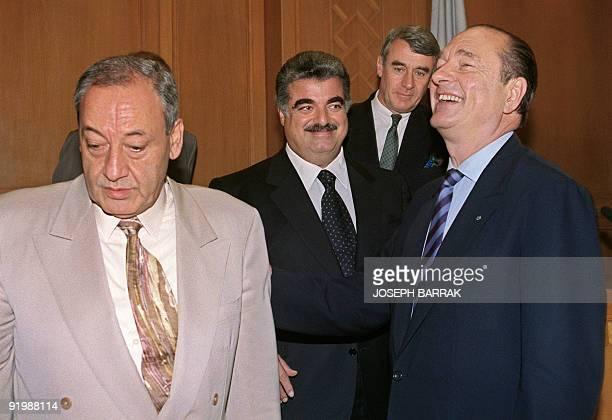 Paris Mayor Jacques Chirac laughs 17 June 1993 as he talks with Lebanon house speaker and former warlord Nabih Berri while Lebanese Premier Rafic...