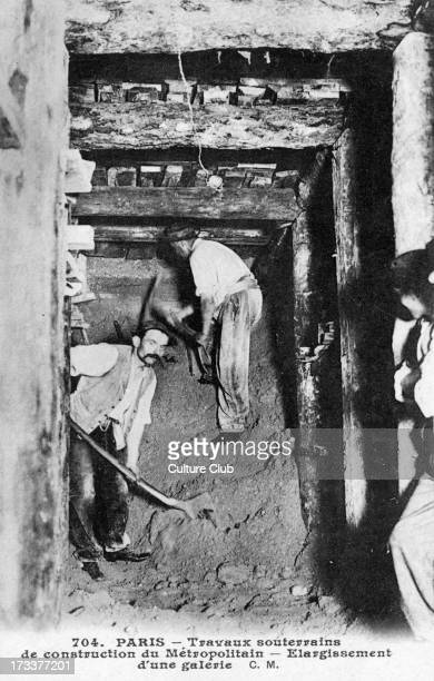 Paris Metro construction of underground track Two men lengthening a tunnel C 1900