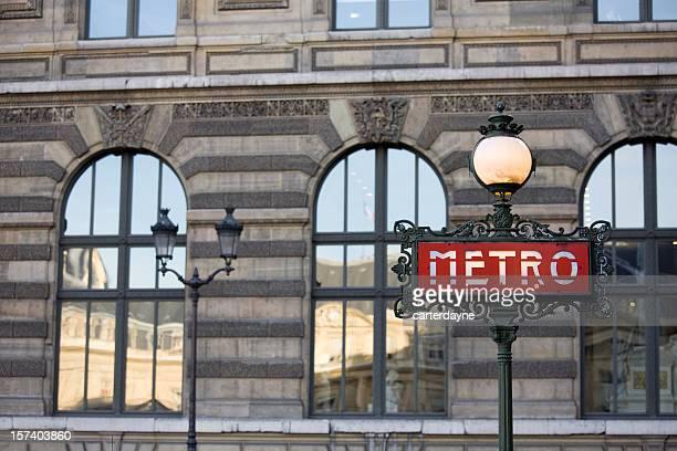 Paris Metro Sign against the Louvre, France