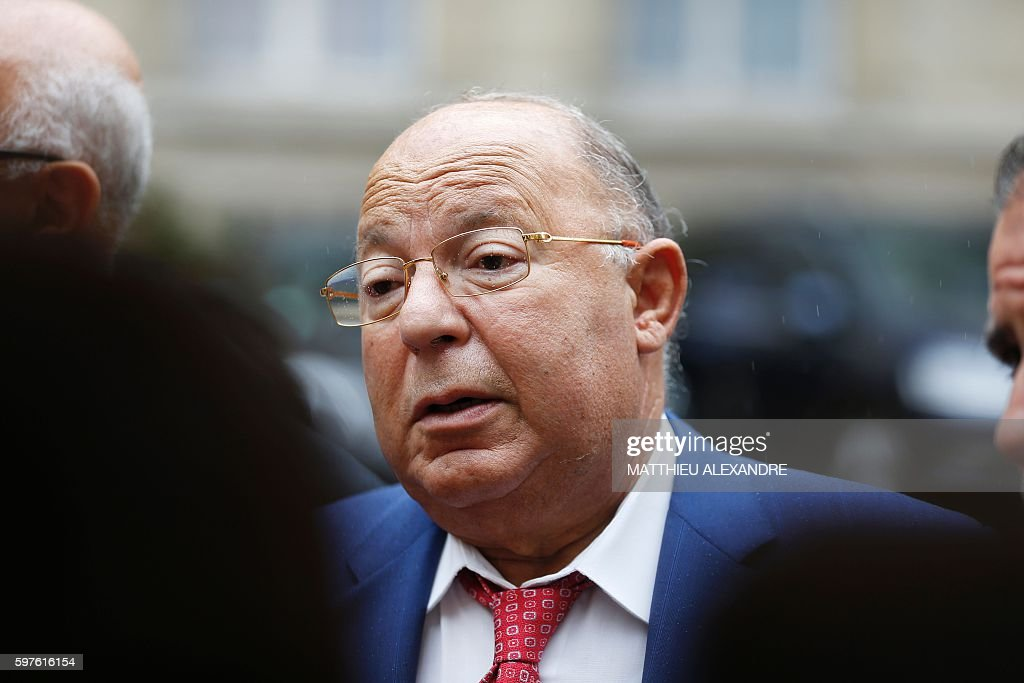 Paris' Mosque Rector Dalil Boubakeur speaks to journalists upon his arrival at the Interior ministry before taking part in a meeting with Interior...