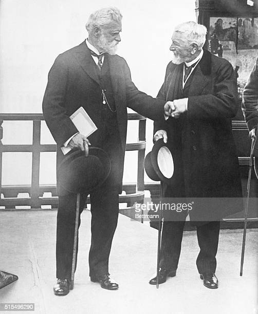 Mr Eiffel on left shaking hands with Mr Swasey President of Wireless Engineers of America Photo made on top of famous tower
