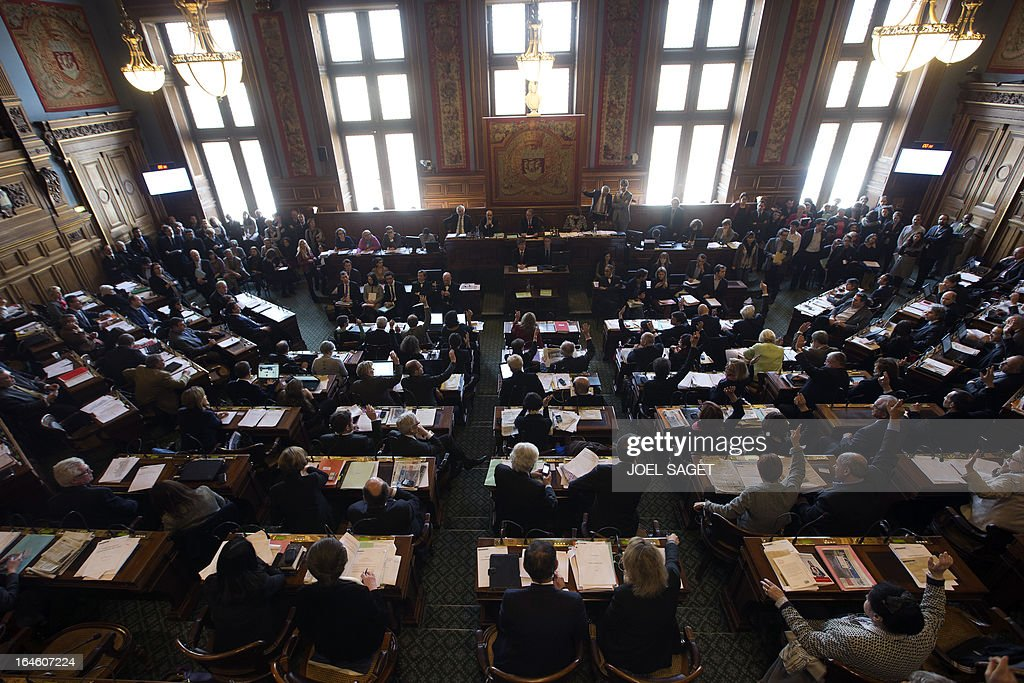 Paris' municipal council is gathered to vote the application for the 2013-2014 schoolyear of a reform law increasing the class time of primary school students, on March 25, 2013, at Paris' city hall.