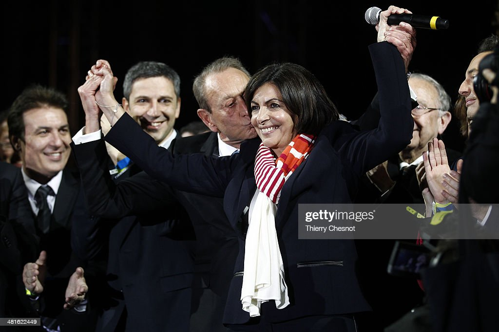 Paris' newly-elected mayor <a gi-track='captionPersonalityLinkClicked' href=/galleries/search?phrase=Anne+Hidalgo&family=editorial&specificpeople=590989 ng-click='$event.stopPropagation()'>Anne Hidalgo</a> and former Mayor <a gi-track='captionPersonalityLinkClicked' href=/galleries/search?phrase=Bertrand+Delanoe&family=editorial&specificpeople=206163 ng-click='$event.stopPropagation()'>Bertrand Delanoe</a> (L) celebrate in front of the City Hall of Paris, after she won the second round of the French municipal elections on March 30, 2014, in Paris, France. <a gi-track='captionPersonalityLinkClicked' href=/galleries/search?phrase=Anne+Hidalgo&family=editorial&specificpeople=590989 ng-click='$event.stopPropagation()'>Anne Hidalgo</a> will be the first female mayor of Paris after a comfortable victory in municipal elections in Paris.