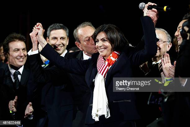 Paris' newlyelected mayor Anne Hidalgo and former Mayor Bertrand Delanoe celebrate in front of the City Hall of Paris after she won the second round...