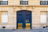 Paris, old wooden door boulevard des Batignolles, beautiful entry porch