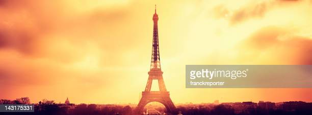 Paris panorama and silhouette of Tour Eiffel view against sun