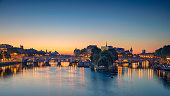 Panoramic image of Paris riverside during sunrise.