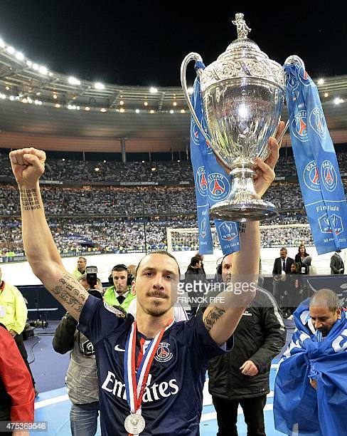 Paris Paris SaintGermain's Swedish forward Zlatan Ibrahimovic celebrates as he holds the trophy at the end of the French Cup final football match...