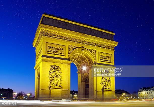 Paris, Place Charles de Gaulle, is facing the Arc de Triomphe at night
