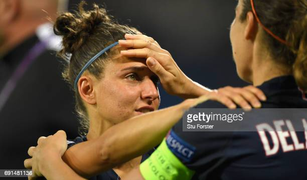 Paris player Sabrina Delannoy comforts Veronica Boquete after the UEFA Women's Champions League Final between Lyon and Paris Saint Germain at Cardiff...
