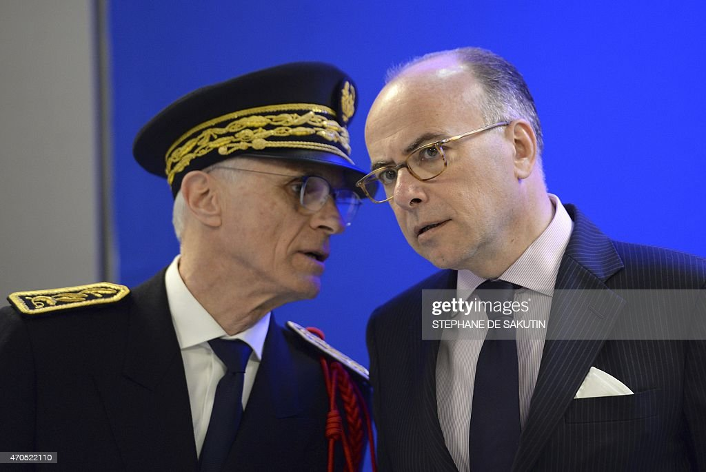Paris police Prefect <a gi-track='captionPersonalityLinkClicked' href=/galleries/search?phrase=Bernard+Boucault&family=editorial&specificpeople=7772884 ng-click='$event.stopPropagation()'>Bernard Boucault</a> (L) speaks to French Interior Minister <a gi-track='captionPersonalityLinkClicked' href=/galleries/search?phrase=Bernard+Cazeneuve&family=editorial&specificpeople=4205153 ng-click='$event.stopPropagation()'>Bernard Cazeneuve</a> during the inauguration of a new police station on April 21, 2015 at the Gare du Nord in Paris.