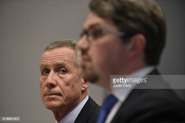 Paris prosecutor Francois Molins and his Belgian counterpart Frederic Van Leeuw address a press conference in Brussels on March 21 2016 Police have...