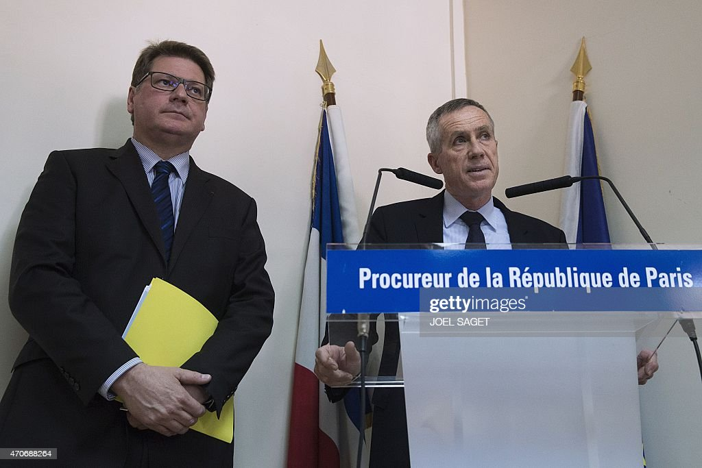 Paris Prosecutor Francois Molins (R), flanked by French Christian Sainte (R), head of French criminal police, speaks during a press conference at the Paris court on April 22, 2015, following the arrest of an IT student who allegedly planned a church attack in France, just over three months after Paris was hit by a jihadist killing spree. French police found Arabic documents mentioning the Islamic State group and Al-Qaeda at the home of the Algerian student, Sid Ahmed Ghlam, suspected of plotting an attack against a French church, Paris Prosecutor said. SAGET