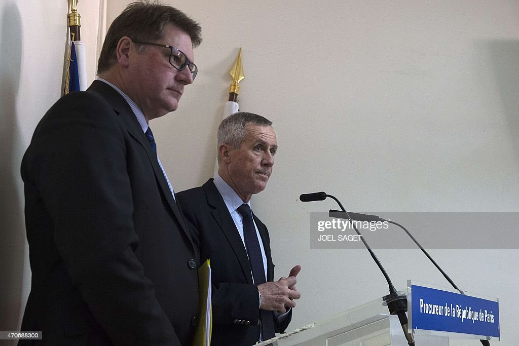 Paris Prosecutor Francois Molins (C), flanked by French Christian Sainte (L), head of French criminal police, speaks during a press conference at the Paris court on April 22, 2015, following the arrest of an IT student who allegedly planned a church attack in France, just over three months after Paris was hit by a jihadist killing spree. French police found Arabic documents mentioning the Islamic State group and Al-Qaeda at the home of the Algerian student, Sid Ahmed Ghlam, suspected of plotting an attack against a French church, Paris Prosecutor said. SAGET