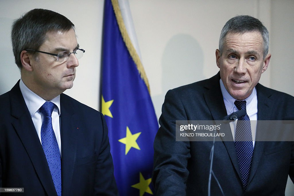 Paris prosecutor Francois Molins (R) gives a press conference flanked by French director of the police Christian Flaesch at the Paris' Courthouse on January 21, 2013. An associate of three female Kurdish activists shot dead in Paris has been charged with their murder, the prosecutor announced following an indictment hearing. The 30-year-old man was one of two ethnic Kurds detained last week by a specialist anti-terrorist unit in connection with the January 9 slayings.