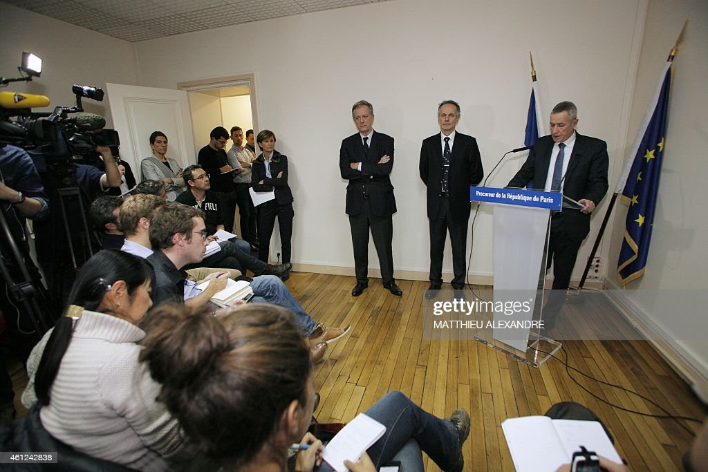 Paris prosecutor Francois Molins (R) holds a press conference on January 9, 2015 in Paris after an hostage-taking at a Jewish supermarket where four hostages were killed in eastern Paris. French elite forces stormed two hostage sites on January 9, killing the brothers behind the Charlie Hebdo massacre and a jihadist accomplice in a fiery end that also claimed the lives of four hostages. The killings brought a dramatic close to three days of terror and high tension that began on January 7 when the two heavily armed Kouachi brothers burst into the satirical magazine's office and slaughtered some of France's best-loved cartoonists.
