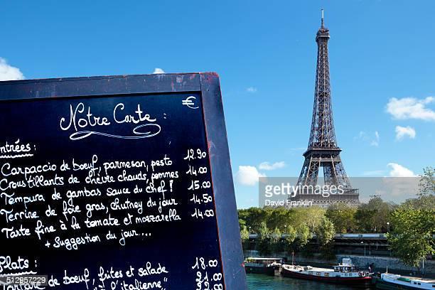 Paris restaurant menu board with Eiffel Tower