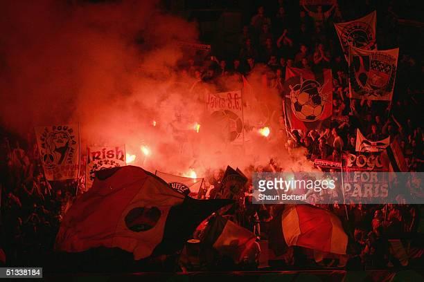 Paris Saint Germain fans light flares during the UEFA Champions League Group H match between Paris Saint Germain and Chelsea at Parc des Princes on...