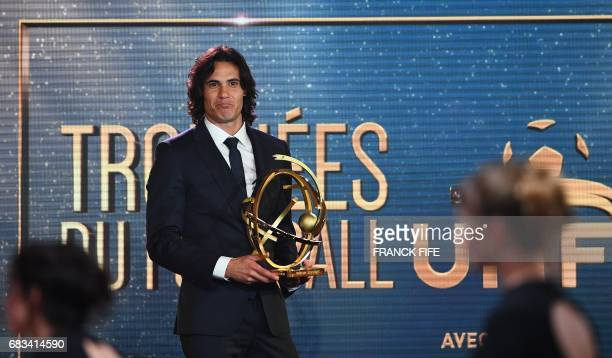 Paris Saint Germain forward Edinson Cavani reacts after receiving the French players' Ligue 1 Player of the Year award during the 26th edition of the...