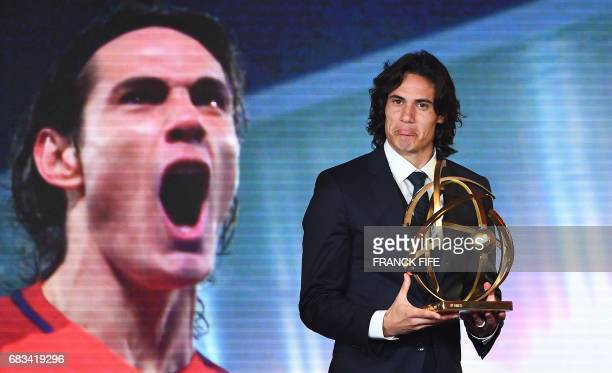 TOPSHOT Paris Saint Germain forward Edinson Cavani reacts after receiving the French players' Ligue 1 Player of the Year award during the 26th...