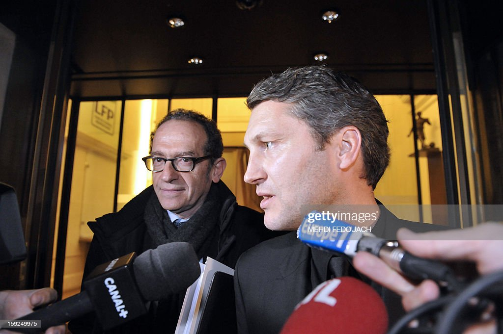 Paris Saint Germain sportive deputy director Olivier Letang (R) and the club's lawyer François Klein talk to journalists as they leave the Professional Football league (LFP) headquarters on January 10, 2013 in Paris, after disciplinary committee gathered about PSG's Swedish forward Zlatan Ibrahimovic. During a French L1 football match Lyon vs Paris on December 16, 2012, Ibrahimovic trampled on Lyon's defender Dejan Lovren's head.