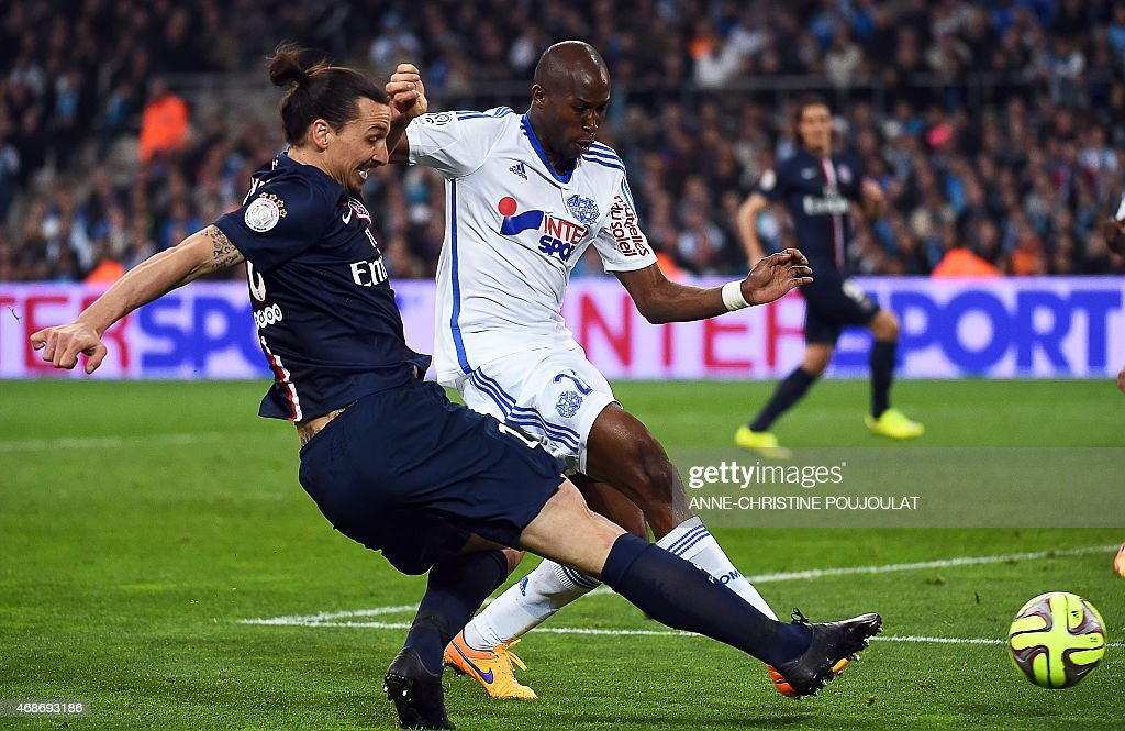 Paris Saint Germain Swedish forward Zlatan Ibrahimovic vies with Marseille's French defender Rod Fanni during the French L1 football match between...