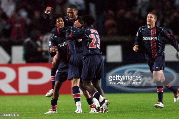 Paris Saint Germain's CharlesEdouard Coridon is congratulated by teammates Pauleta Modeste M'Bami and Jose PierreFanfan