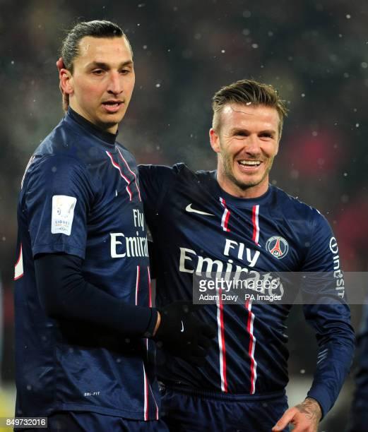 Paris Saint Germain's David Beckham and Zlatan Ibrahimovic celebrate the second goal during the Ligue One match at Parc des Princes Paris France